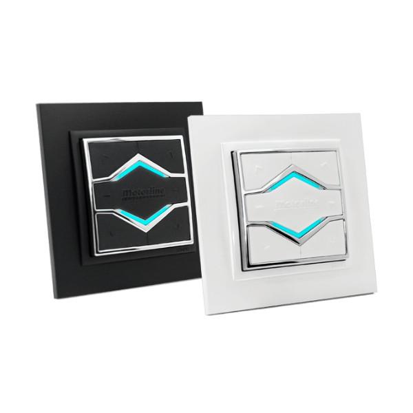 2-kanavainen seinapainike pysyy magneetin avulla seinään kiinnitettävässä kehikossa.